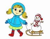 Bambina con la slitta e il pupazzo di neve