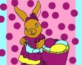 Coniglietta di Pasqua con l'annaffiatoio